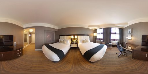 BOS_Premium Double A living room filled with furniture and a flat screen tv. A hotel room with two beds and a desk. A living room with a couch and a table. & 360player - Immersive images of and