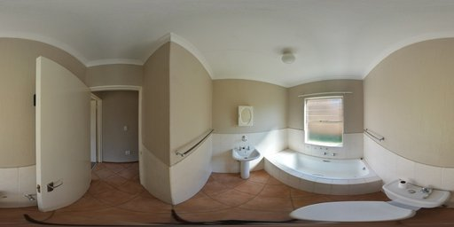 A Bathroom With A Toilet, Sink, And Mirror. A Bathroom With A Tub, Sink, And  Toilet.